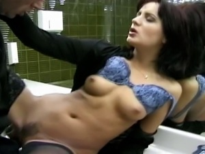 Hot black hair big boob MILF is sucking a young cock while she is fingering...