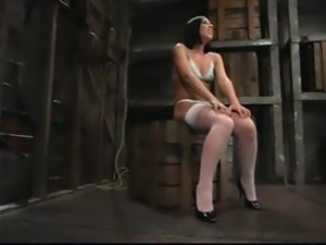 Brunette Julie Night is strung up and gagged in the dungeon for punishment