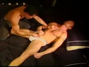 CBT Hot hung smooth muscle stud has balls punched and squeezed by another hot...
