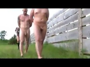 Beautiful tattooed mistress plays with her two hunky sex slaves