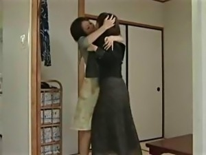 Young Japanese teen gets some lesbian attention  from a hot MILF and her...