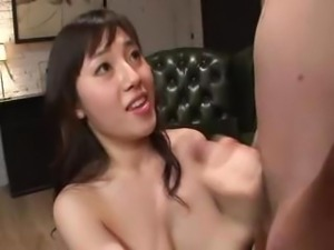 Busty Azusa Nagasawa works on two cocks blowing and banging for a creampie