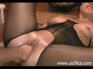 Hot brunette fist fucked into a frantic orgasm