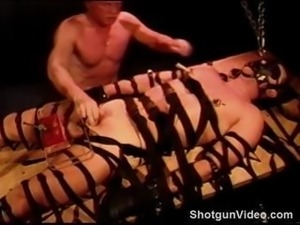 CBT my bottom is bound, gagged and hooded as I crush his balls in a clear...