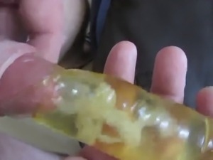 Cum into waterfilled condom under foreskin!!!