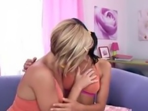 two lesbo girls banging a dildo machine