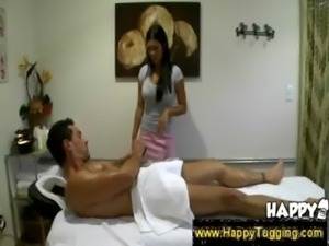 Masseuse slides hand under a towel free