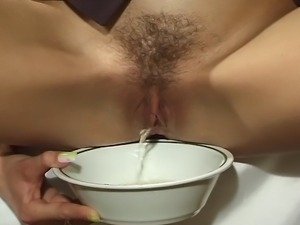 Crazy slut taped as she was pissing in a bowl and sent us a copy...