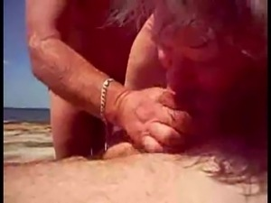 Help Him Cum At The Beach