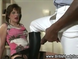 Mature stocking brit Lady Sonia interracial blowjob
