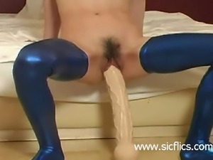 Submissive slave is brutally fucked with a monster dildo in her loose vagina