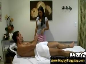 Masseuse slides hand under a towel free