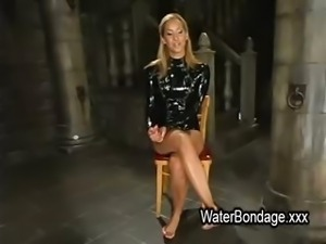 Tied blonde hottie tortured with ice and sunk in water tank