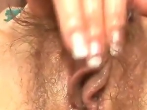 Ryo Kaede plays with her pussy in black fishnet panties before breaking out...