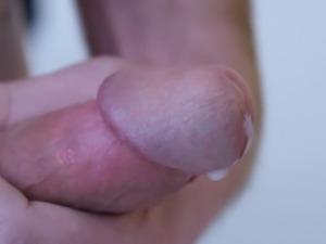 Extreme closeup jerking and cumshot circumcised cock