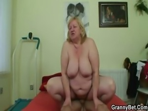 Huge granny swallows his horny cock
