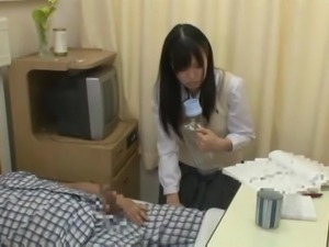 asian school girl takes care of a cock