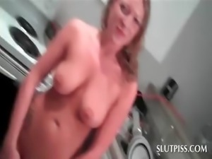 Busty blonde sex siren stripping naked to piss