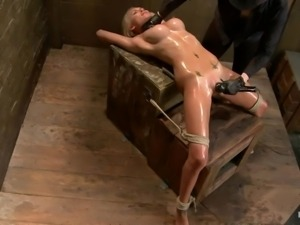oiled blonde punished
