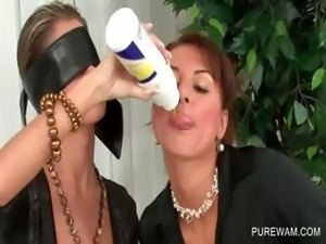 Lesbo clothed hottie gets covered in messy cream