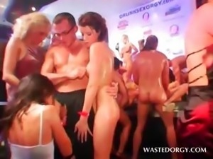 Sexy sluts sharing loaded dick in gangbang at an orgy