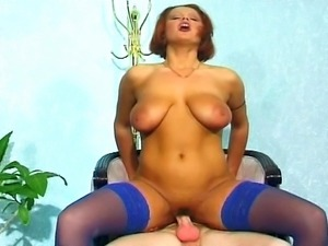 After a romantic dinner with her lover, this big boobed redhead slut gets her...