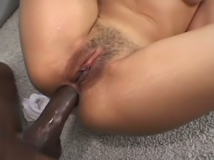 Ebony beauty takes big black cock in her ass.