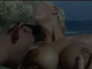 Gorgeous big titted blonde beach anal