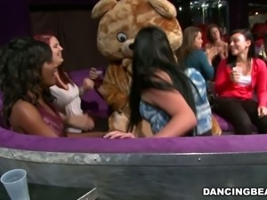 dancing bear with ladies in her lap