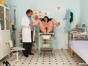 brunette whore at her gynecologist receives a milk enema