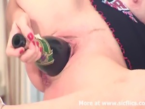 Horny amateur MILF fucks her massive vagina with the bottom end of a huge...