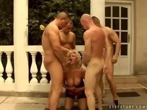 Granny sucking four big cocks