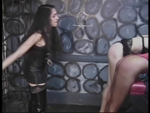Sexy dominatrix bends two sluts over for abuse
