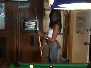 The prepossessing brunette ebony Jasmine Rios plays billiards with her...