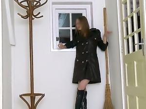 The seductive brunette Gloria in black cloak and with a cigarette...