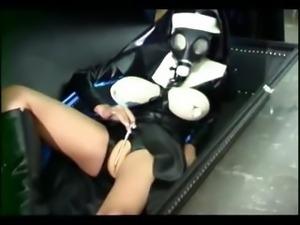 Busty girl in latex masturbating