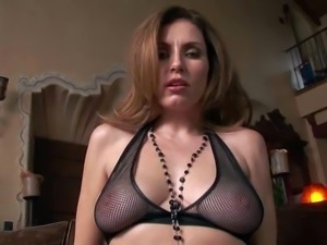Jamie Lynn is a brown haired seductress with big natural
