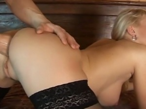 Blonde bitch takes a fist in her ass hole
