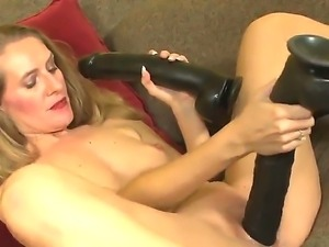 Look at adorable MILF Sara James getting herself off with monster black dildos