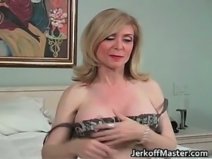 Sexy blonde MILF is stripping