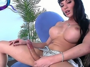 Fascinating shemale mistress Mia Isabella with huge boobs and sexy face jerks...