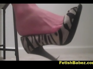 Watch Amber dangling her sexy heels on her feet while popping some gums and...