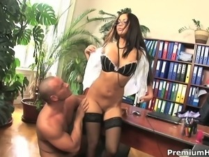 Dark haired charming secretary Angelica Heart in glasses spreads her