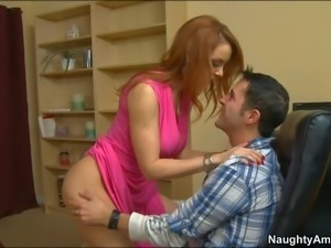 Janet Mason is a busty redhead milf that loves to