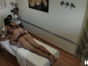 Asian massage girl oiled her body and her clients cock to jerk off it better