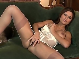 Awesome temptress Danni Gee in super sexy lingerie and high heels fingers her...