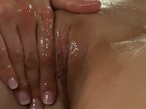 Aubrey Belle and Celeste Star are oiling their friend, Sammie, to make her...