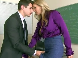 MILF teacher Julia Ann with huge boobs is sex hungry.