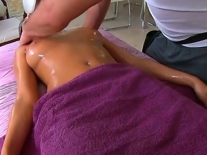 Tanned brunette Breanne Benson gets her body oiled and professionally massage...