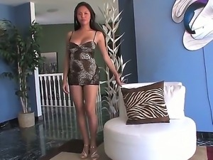 Sexy looking asian shemale Taylor Stewart enjoys in showing her curves in a...